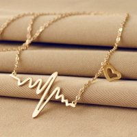Gold colored heartbeat necklace